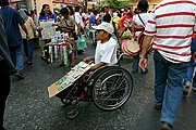 Disabled Man in a Wheelchair selling Sweepstakes Tickets near Quiapo Church