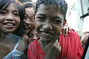 Close-Up Shot of Smiling Boy and Friends in Delpan, Tondo, Manila