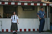 Student and a Policeman Waiting on the Street in Tagaytay