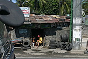 Adult and Small Child, Vulcanizing and Repair Shop in Imus, Cavite