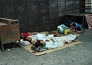 A Group of People Sleeps at the Bus Station in Angeles City