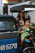 Little Girl Driving a Motorcycle