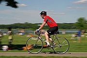Bicyclist Riding Past Picnic Area of Lake Calhoun, Minneapolis