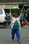 An Old Lady Carrying a Basin and Crossing the Street in Baguio City, Philippines