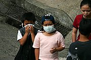 Children Wearing Surgical Mask Because of Meningococcemia Outbreak in Baguio City, The Philippines