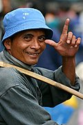A Smiling Old Man Uses a Bamboo Rod in Carrying His Goods in Baguio Public Market