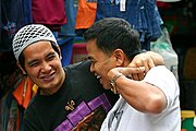 Two Happy Men Laughing Together in the Baguio City Public Market, the Philippines
