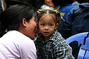 A Mother Whispering to Her Daughter in Baguio City, Philippines
