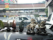 Figurines in the Dashboard of a Taxicab