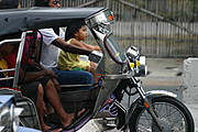 Young Girl Riding on Tricycle's Gas Tank