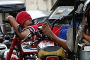 Tricycle Driver Sleeping on his Motorcycle