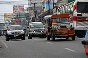 Cars, Jeepney, and bus on MacArthur highway, Pampanga, Philippines