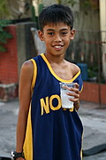 Filipino Boy Posing with Cold Drink on Hand