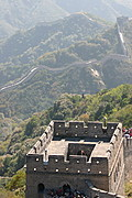 A Watchtower and the Great Wall of China Winding Across the Hills