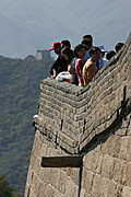 Tourists on the Edge of the Great Wall of China