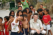 American Posing with Filipino Kids in His Neighborhood