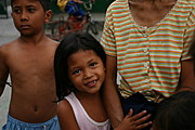 Smiling Filipina girl Holding onto an Adult