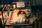 Newborn Stirring in His Bed at the Neonatal Intensive Care Unit of ONA