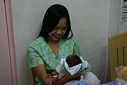 Nurse Taking Care of Infant in Ospital ng Angeles' (ONA) Nursery