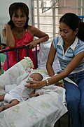 Mother Assisting Baby with Inhaler in Ospital ng Angeles' (ONA) Nursery