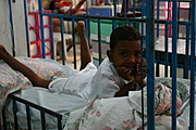 Young Filipino Boy Posing on His Bed in the Pediatric Ward