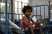 Thin Child Staring at the Camera from her Bed at the Pediatric Ward, Ospital ng Angeles