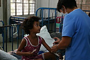 Nurse Giving Injection to Young Patient at ONA