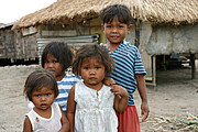 Toddler/Pre-School Aeta Kids Standing in front of a House