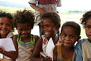 Aeta Kids Holding Photo of Themselves