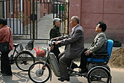 Old Chinese Couple Traveling on a Bicycle