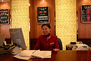 Clerk at the Red Wall Hotel in Beijing