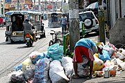 Man Sorting Garbage in Bacoor, Cavite