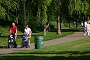 Parents Pushing Baby Strollers on Lake Calhoun Walking Path