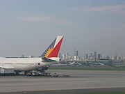 Philippine Airlines Jet and Makati Skyline, Manila