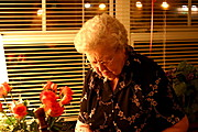 Grandmother in her Apartment with Flowers