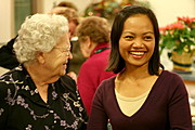 Mature Woman and Young Lady Laughing Together