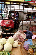 Produce Vendor Sleeps in Traffic, Manila, Philippines.