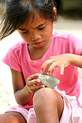 Pre-School Girl Playing with a Rock, the Philippines