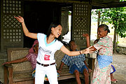 Young Filipina Dancing Ilocano Folk Dance (Karinosa) with her Aunt