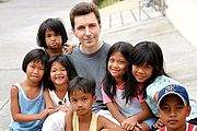 American with Neighborhood Children in Angeles City, Philippines