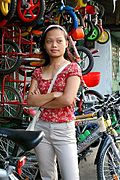 Woman Standing Outside a Bike Shop in Angeles City