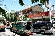 Jeepney on Crowded Manila Street