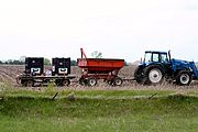 Tractor with Trailers in a Corn Field