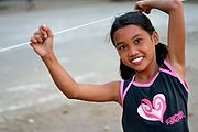 Girl Holding Clothes-Line, Rural Philippines