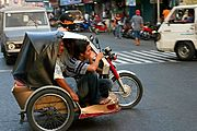 Trike with Passengers in Downtown Laoag
