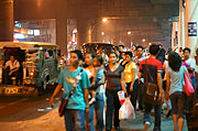 Commuters Waiting for Jeepneys in Cubao, Manila