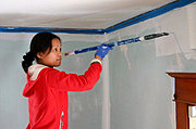 Woman Painting Bedroom with Roller