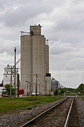 Grain Elevator next to Railroad Tracks