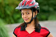 Young Asian Woman in Bike Helmet