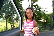Girl Selling Fruit by the Road, Philippines